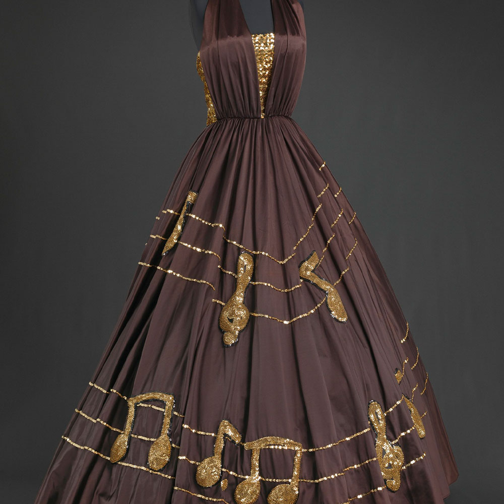 brown dress with gold music notes